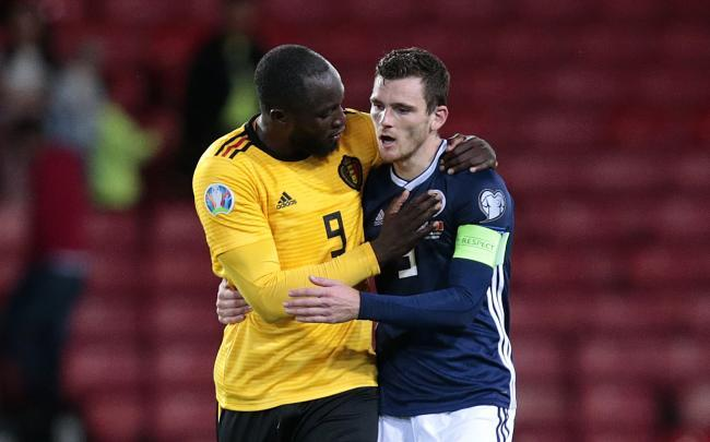 Scotland's Andrew Robertson with Belgium's Romelu Lukaku after the final whistle at Hampden on Monday night. Picture: PA