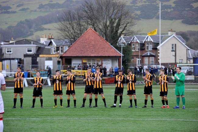 A minute's applause at Barrfields in memory of Colin Weir before the Largs v Clydebank match