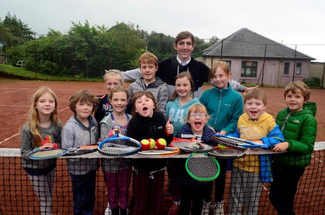 Coach Neil Jones and Skelmorlie youngsters at last year's tennis coaching.