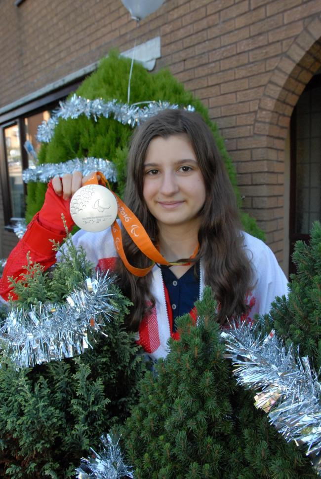 Abby pictured with her silver medal from the Rio Paralympics.