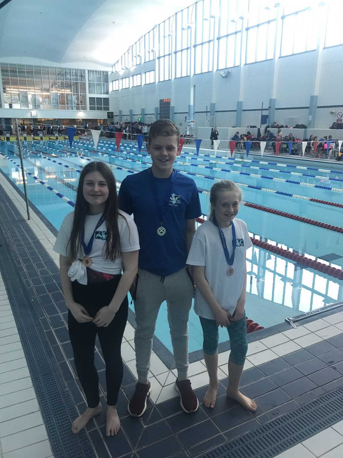 Picture: L – R Rachel McGuire, Fraser Kelly, Isla Waller with their medals