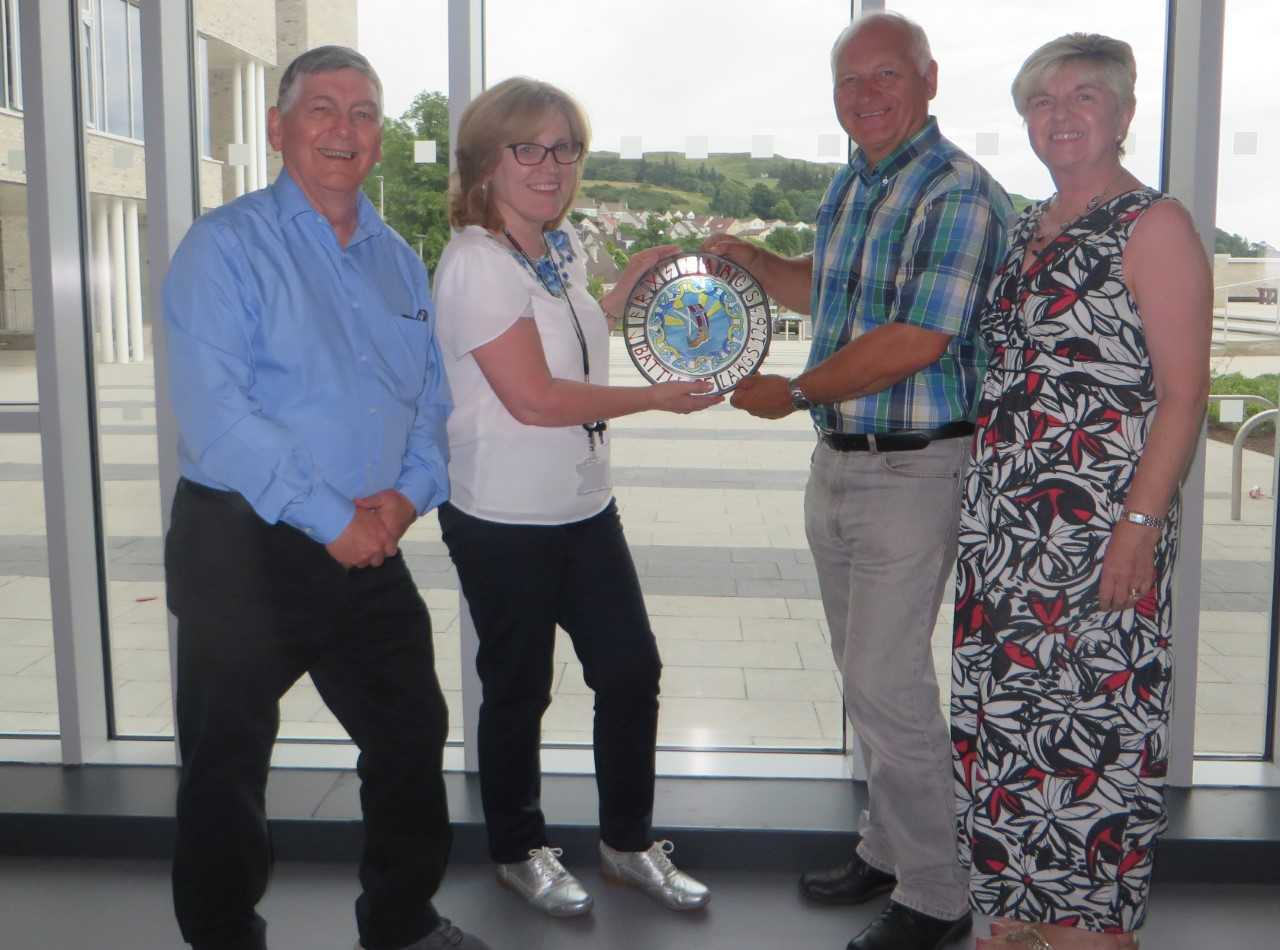 Viking stained glass given to Largs Acadamy, Alex Gallagher Chair of the Festival, Heather Burns, Head Teacher Largs Academy, Linda Young, Secretary Largs Viking Festival and Ray Young, Director Largs Viking Festival