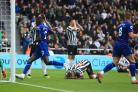 DeAndre Yedlin, centre, is distraught after his own goal handed Chelsea victory