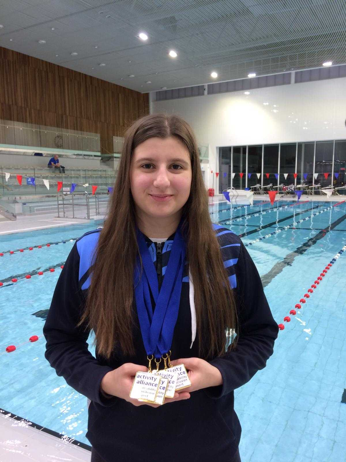 Largs swimmer Abby Kane's clean sweep of gold medals