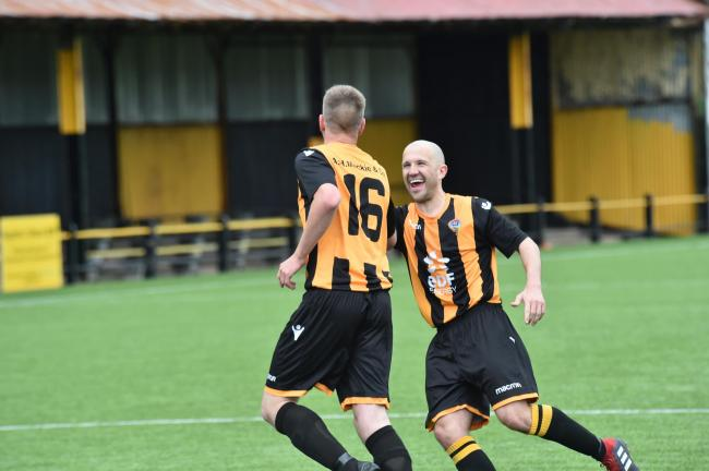 Scott Adam wheels away after hitting Thistle winner from spot, with Gary Fleming joining in celebrations.